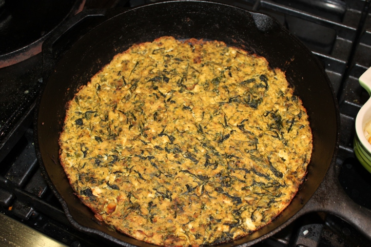 Arugula and Dill Frittata baked in a cast iron pan