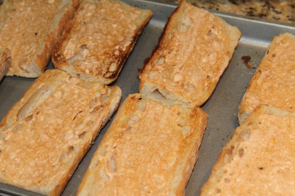 Toasted french baguettes with vegan sriracha mayo