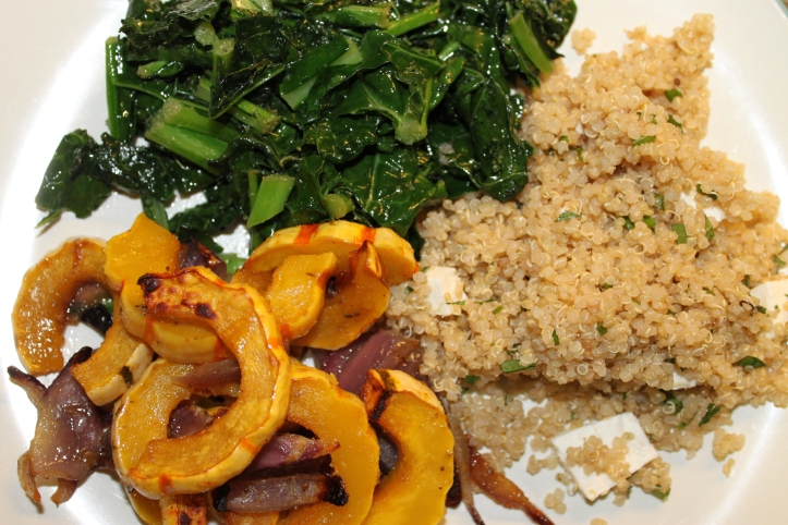 Delicata squash served with kale and quinoa